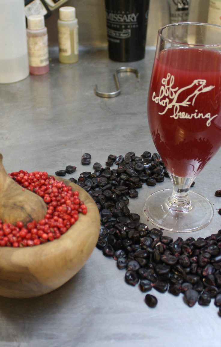 The Field Museum partnered with Off Color Brewing to produce Wari, a beer named for its ancient creators. Wari, shown here surrounded by purple corn and pink peppercorns has a 4.0% ABV and IBU of about 3.