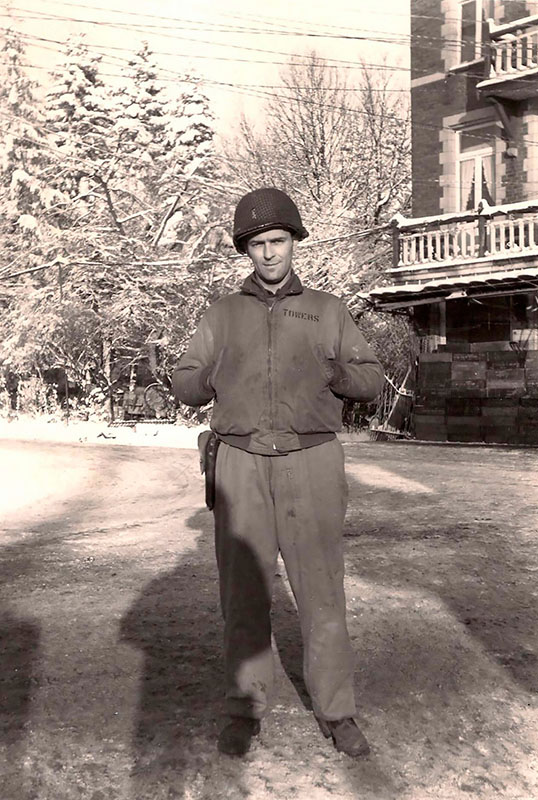 Frank Towers standing on street with snowy building and trees in background