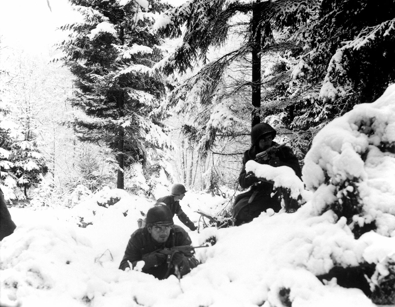 soldiers hiding in snowy bushes