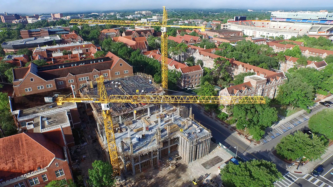 An aerial view of the new chemistry building and two large yellow cranes.