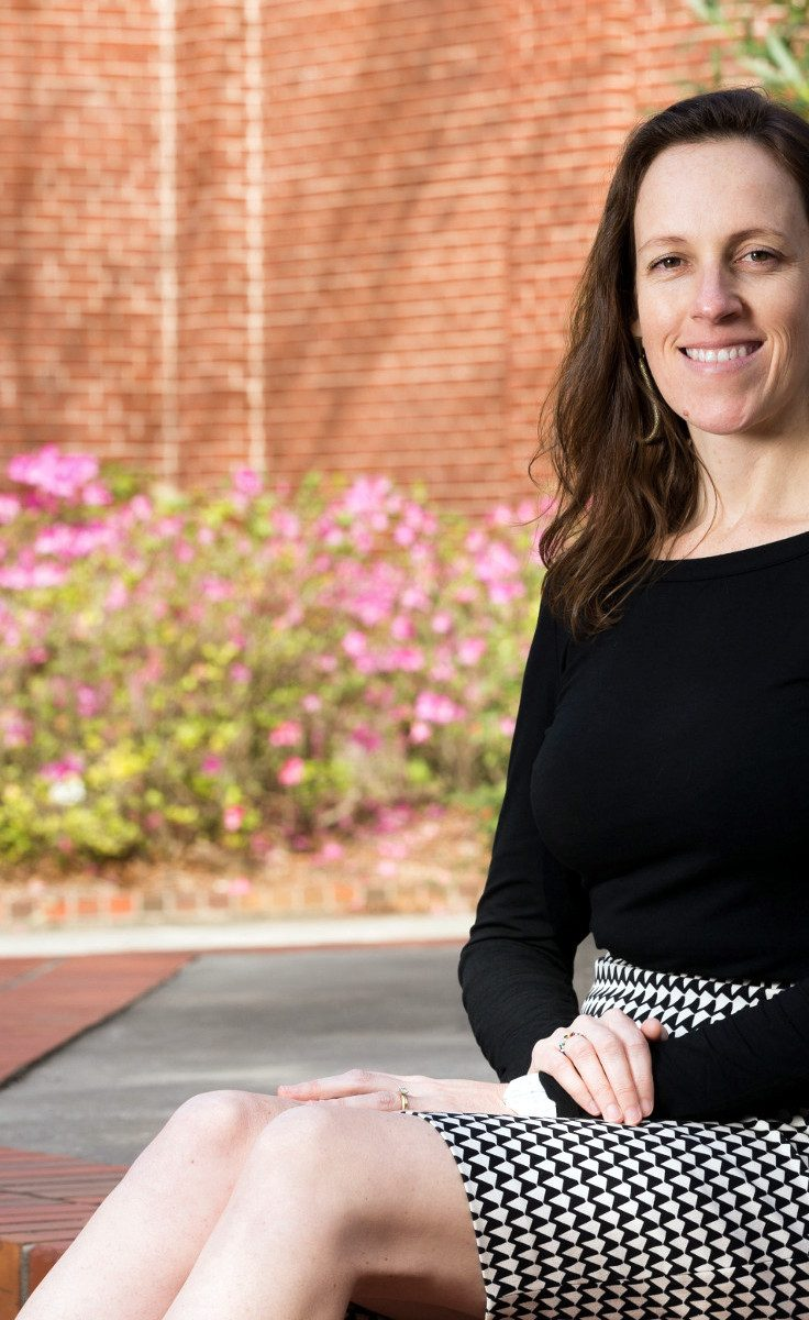 Andréa Ferreira sits on UF campus