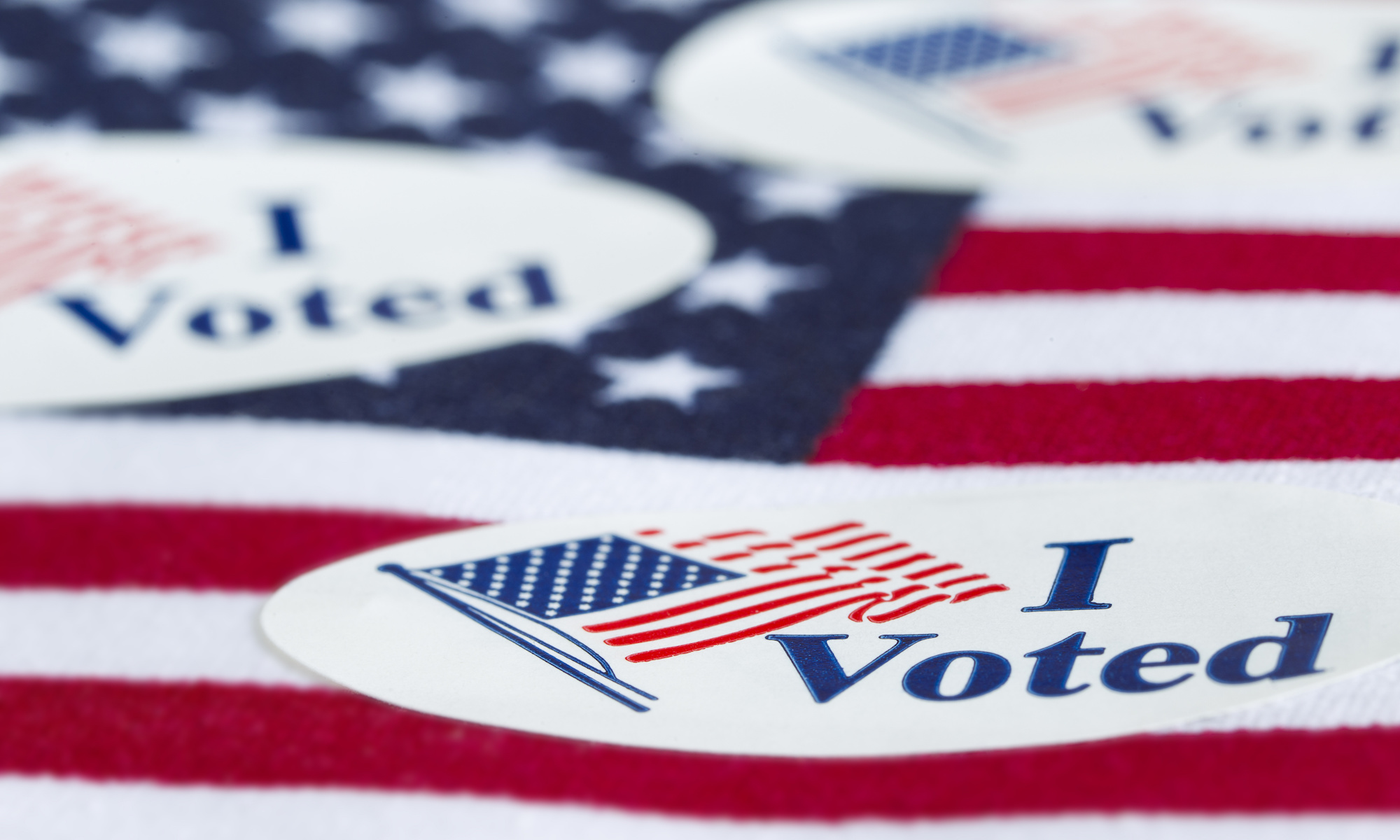 'I Voted' stickers on the US flag background