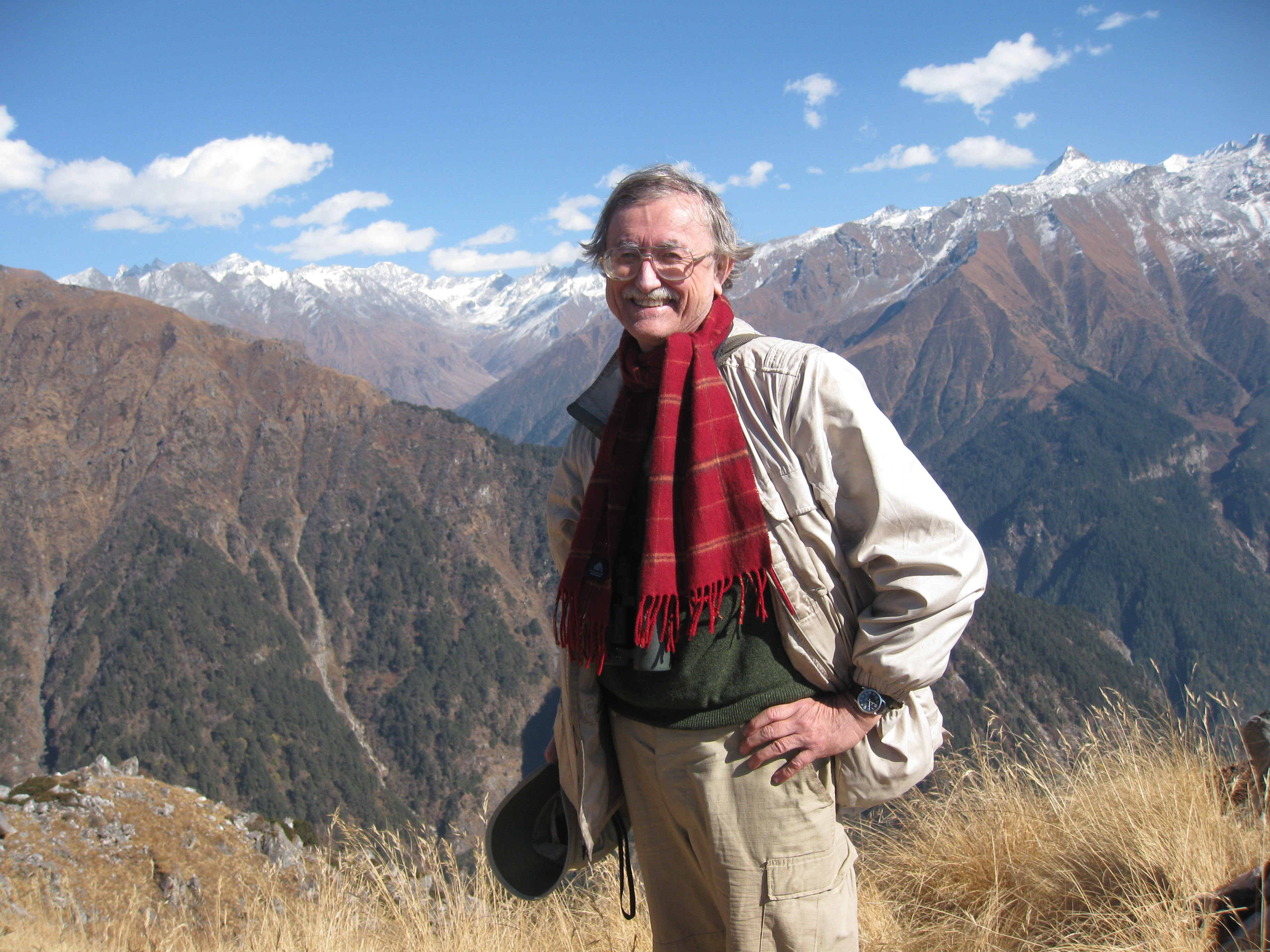 Bob Holt standing with mountains behind him