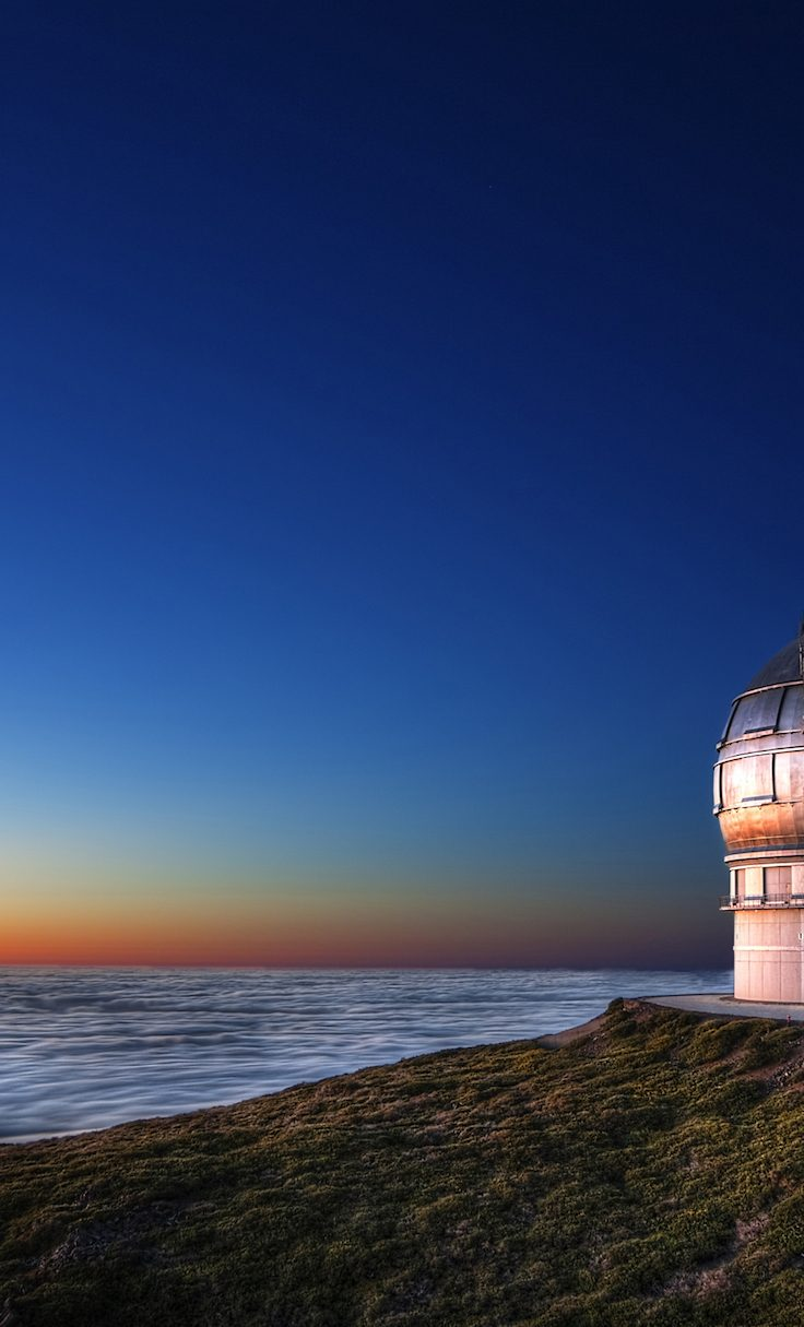 photo of telescope overlooking ocean