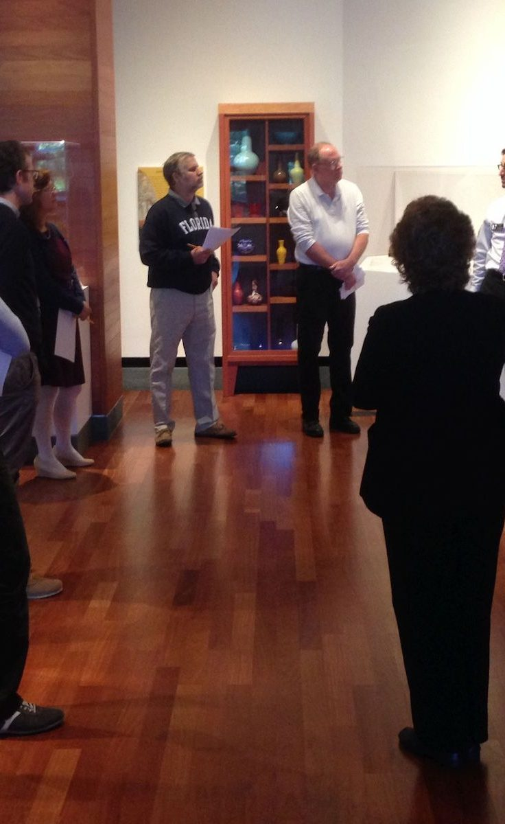 UF poli sci faculty standing in Harn gallery