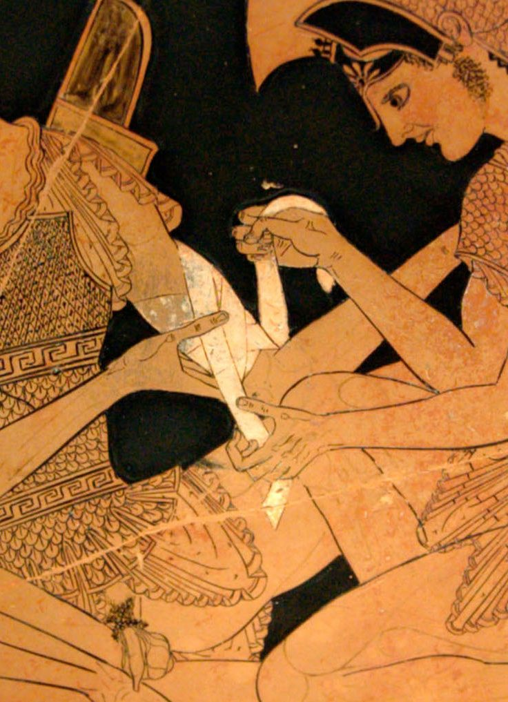 closeup of Grecian painting depicting soldier bandaging another's arm