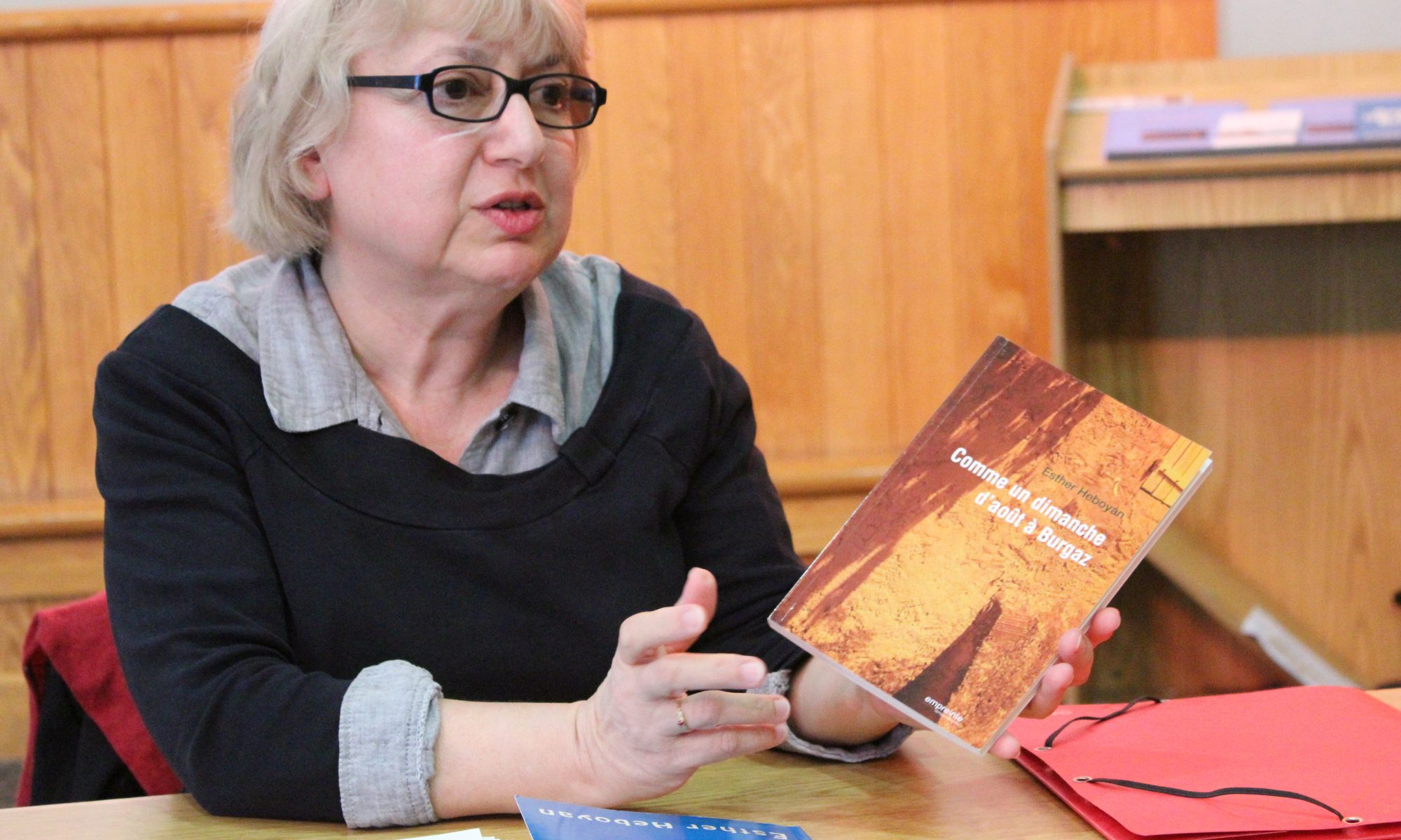 Esther Heboyan holding book and speking
