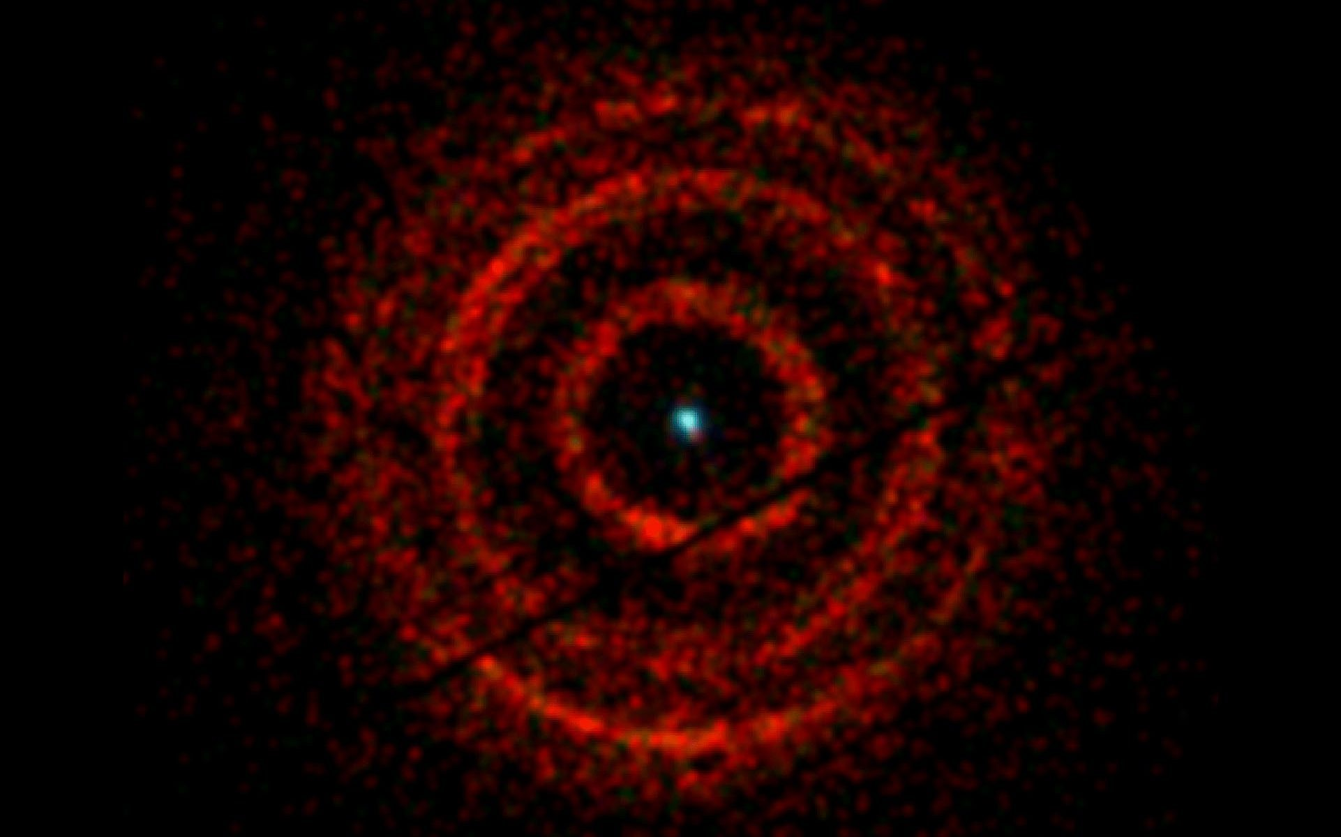 red ringed rendering of black hole