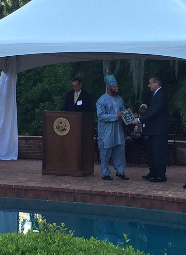 A picture of Dr. Vincent Adejumo receiving award